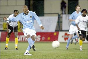 Man City's Nicolas Anelka takes a penalty