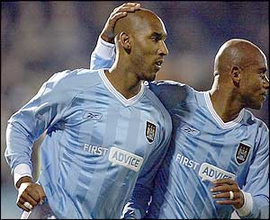 Man City's Nicolas Anelka celebrates his goal