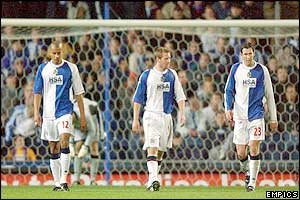 Blackburn's players walk back to the centre circle after conceding a goal