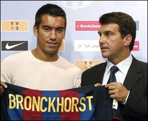 Giovanni van Bronckhorst joins Barcelona on a season-long loan