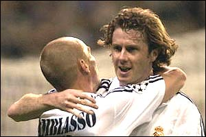 Steve McManaman celebrates with Real Madrid team-mate Estaban Cambiasso