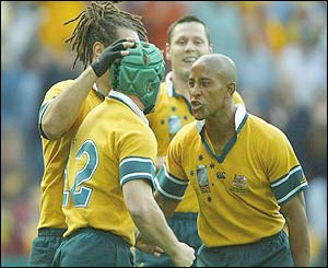Australia's Elton Flatley is congratulated after scoring