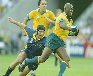Australia's Wendell Sailor skips out of a tackle