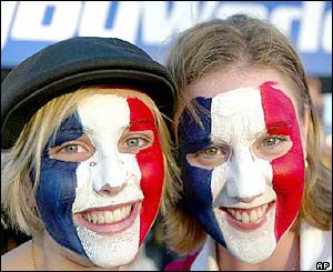 France fans dress up for the camera before their match with Japan