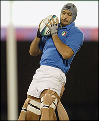 Italy's Marco Bortolami gathers the ball at a line-out during the first half