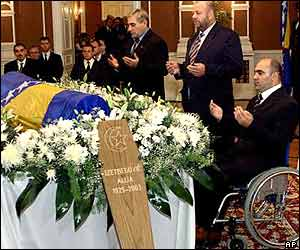 Bosnians pray over body of Izetbegovic as he lies in state surrounded by flowers