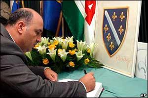 Representative of the Palestinian embassy in Bosnia, Majed Maarout, signs a condolence book for Alija Izetbegovic