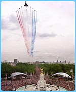 Concorde leads the Red Arrows in a fly-past for the Queen's Golden Jubilee