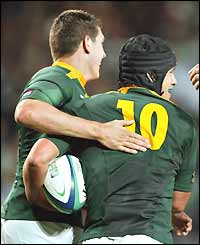 Derick Hougaard (right) is congratulated on his try - South Africa's second