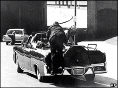 President Kennedy's car speeds away after the shots had been fired