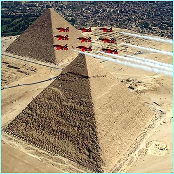 The Royal Air Force Red Arrows perform a historic display over the Giza Pyramids in Egypt
