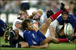 France's Fabien Galthie is tackled by the Scottish defence