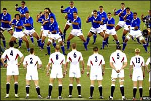 England's rugby players stare down the Samoan opposition before the kick-off