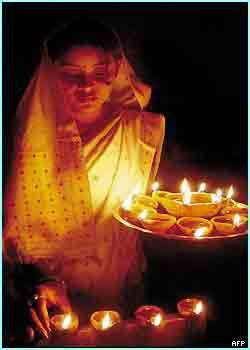 An Indian girl lights candles on the eve of the Diwali festival in Guwahati, northern India