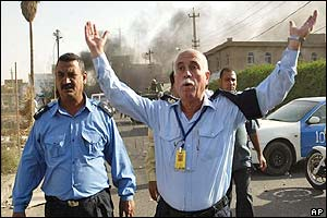 Iraqi police wave back bystanders following ICRC blast