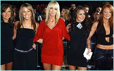 Girls Aloud, looking as glam as ever, pose for cameras at the National Music Awards in London on Sunday night