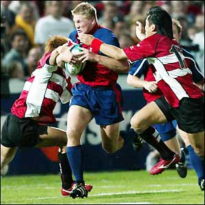 The USA's scrum-half Kevin Dalzell charges the Japan defence