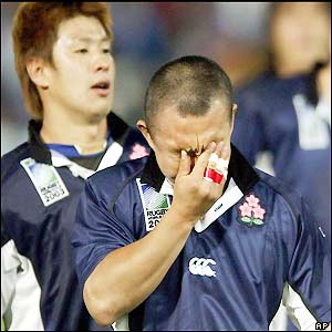 Japan's Takashi Tsuji is disappointed after his side's defeat
