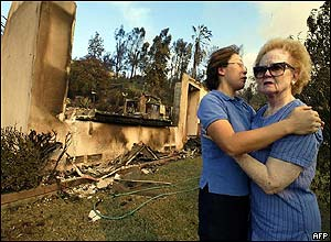 A woman is consoled after her house is destroyed in San Bernadino