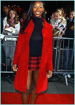 Jamelia's stunning scarlet outfit blends in well with the red carpet