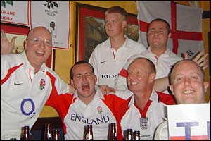 England fans celebrate their win over the Springboks