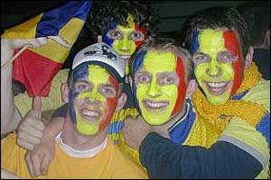 Romania fans cheer on their team against Argentina
