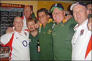 England and South Africa fans watch the game between the two countries