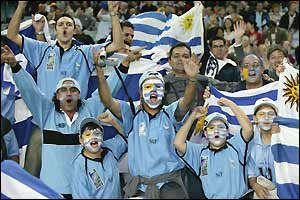 The Uruguay fans celebrate their team's 24-12 win over Georgia