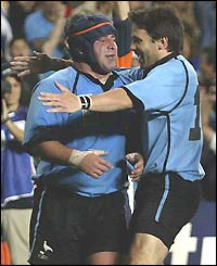 Diego Lamelas (right) in congratulated on scoring Uruguay's second try