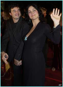 Carrie-Anne Moss who plays Trinity arrived with her husband, Steven Roy