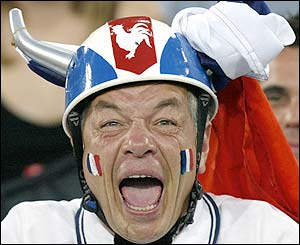 A France fan shouts prior to kick-off against New Zealand