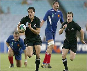Mils Muliaina of New Zealand goes on a break