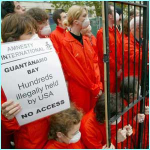 Members of Amnesty International protested by dressing up as prisoners outside the Prime Minister's office.