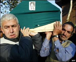A coffin of one of the 27 people killed in the blasts is transported for burial