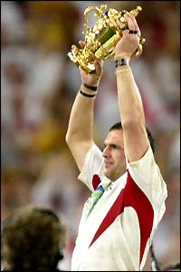 Skipper Martin Johnson finally gets his hands on the ultimate prize and lifts the Webb Ellis trophy