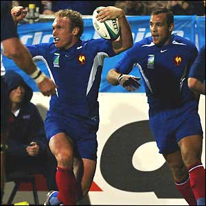 France centre Brian Liebenberg celebrates scoring France's first try