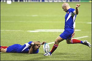 Fly-half Gerald Merceron (right) kicks a conversion for France
