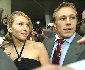 Jonny Wilkinson (right) and his girlfriend Di Stewart leave the England team hotel
