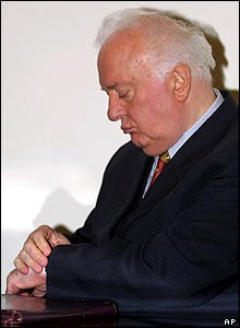 Mr Shevardnadze looks at his watch