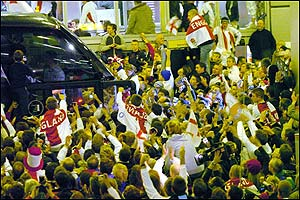 England fans mob the team bus