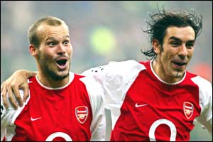 Freddie Ljungberg celebrates with Robert Pires after scoring three minutes after the break