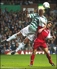 John Hartson of Celtic jumps with Bayern's Bixente Lizarazu