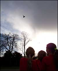 Schoolchildren in Bristol watch the final flight of Concorde, as photographed by a BBCi user