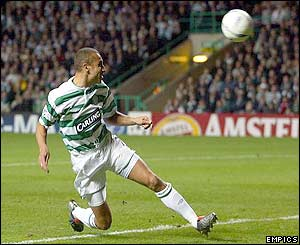Celtic's Henrik Larsson heads the ball towards goal