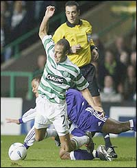 Celtic's Henrik Larsson is fouled by Vincent Kompany