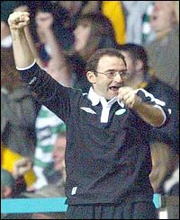 Celtic boss Martin O'Neill punches the air with delight as Celtic claim victory