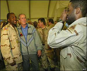 Bush poses with a soldier