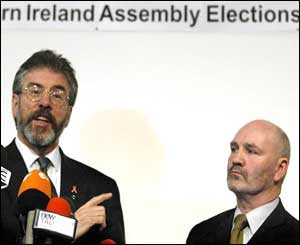 Sinn Fein President Gerry Adams (left) with the party's successful South Belfast candidate Alex Maskey