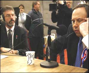 Sinn Fein's Gerry Adams and the DUP's Nigel Dodds take part in a radio interview at the Belfast count