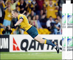 Australia's Stirling Mortlock scores the first try